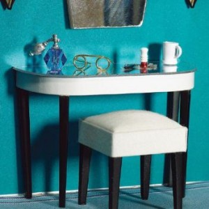 The mirrored table and tapered legs give this 'Art Deco' dressing table the period touch it needs.